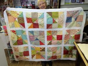 mum kindly modelling the quilt.